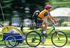 Mother with child in bike trailer - Liberty Park, Salt Lake City, Utah - 4-2 - 72 ppi