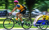Mother with child in bike trailer - Liberty Park, Salt Lake City, Utah - 3-2-2 - 72 ppi