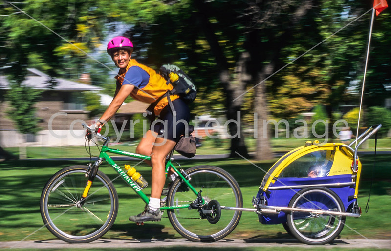 Mother with child in bike trailer - Liberty Park, Salt Lake City, Utah - 13 - 72 ppi