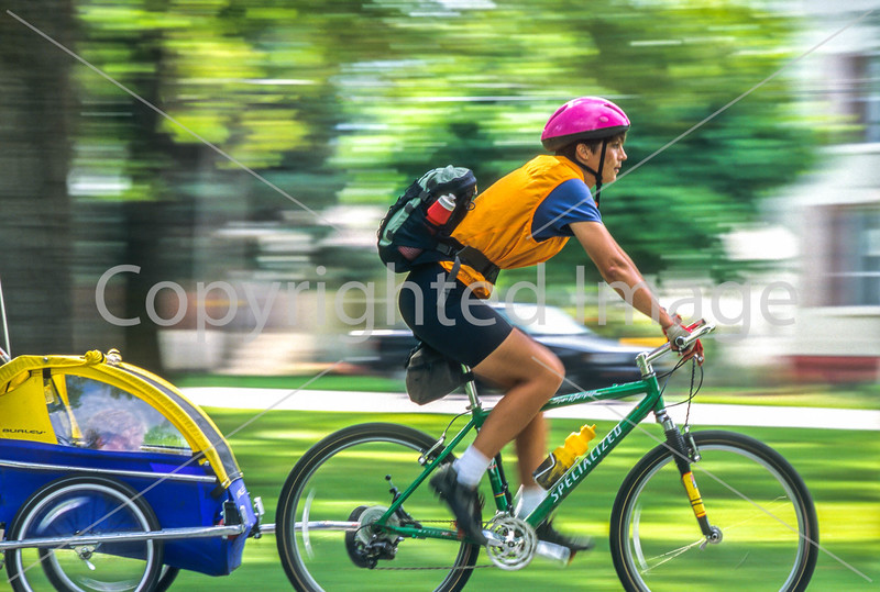 Mother with child in bike trailer - Liberty Park, Salt Lake City, Utah - 1-2 - 72 ppi