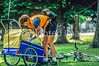 Mother with child in bike trailer - Liberty Park, Salt Lake City, Utah - 8-2-2 - 72 ppi