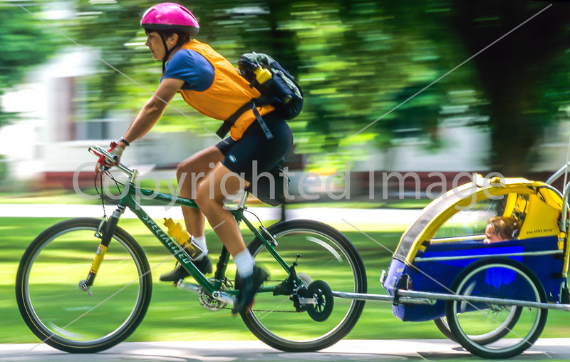 Mother with child in bike trailer - Liberty Park, Salt Lake City, Utah - 17-2 - 72 ppi