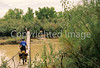 Mountain biker on bridge over San Juan River - on way to 16 House Ruin  - B ut sjrb 1