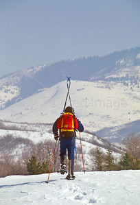 SN ut wstc 47 - ORps - Snowshoer packing cross-country skis into Utah's Wasatch Mountains near Salt Lake City - 72 ppi
