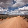 Cumulus Clouds Above a Desert Dirt Road