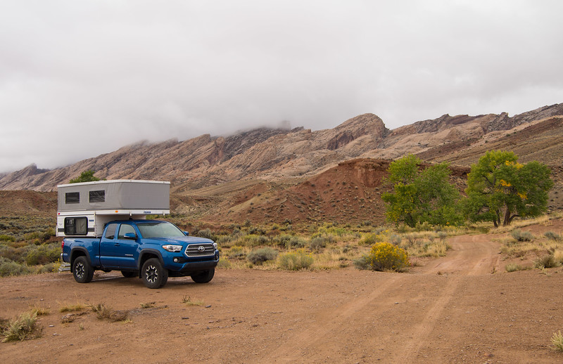 "October 2, 2017. Clouds blanket the San Rafael Swell near Green River on a drizzly  morning- the first day of our annual fall desert trip. Steady rain for much of the night forced us to rethink our plans, which had been to spend the next two days off-road in the San Rafael Desert- not the best idea with a bit more rain in the forecast, on roads described as ""impassible when wet"". Been there, done that- they mean it!<br />  The new Bears Ears National Monument area had been next on the agenda anyway,  so we headed south away from the storm, hoping to find dryer conditions."