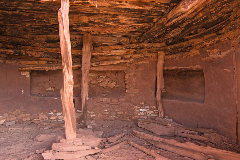 The exterior wall of the kiva is partially broken down, allowing a view inside.