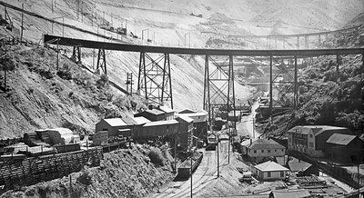 Armstrong Tunnel in 1941, showing the original loading bins, plus the second loading bins built by Bingham Metals after they had moved their surface facilities in 1931.  The steel railroad bridge in this photo was known as the 'I' Bridge, and was built in 1939.