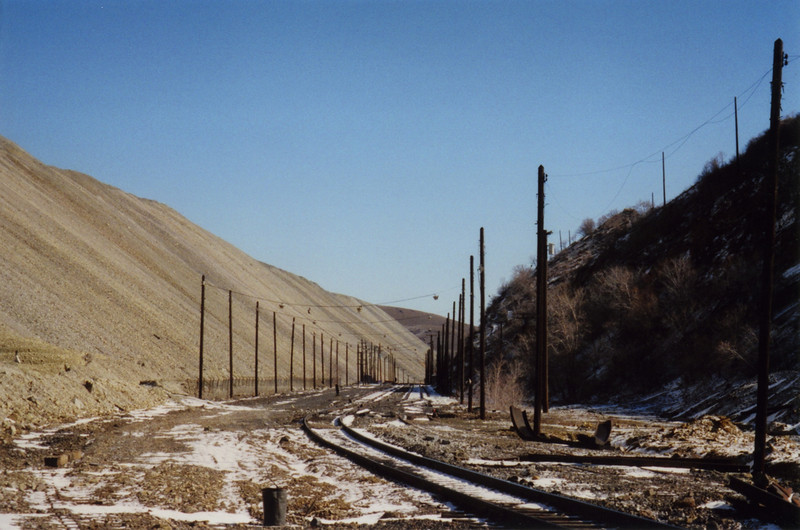 Having to keep the rail corridor open had become too costly, while being able to abandon the rail corridor and fill it with waste rock would solve several operational and environmental problems. March 19, 2000.