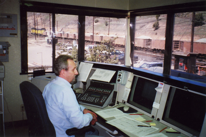 The last ore train passes the Copperton dispatch tower. May 30, 2001.