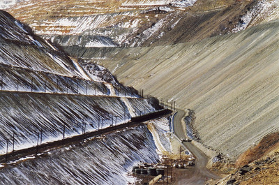 The last ore train travels down Bingham Canyon. Note how the waste dumps were encroaching on the rail corridor on both sides. March 19, 2000.