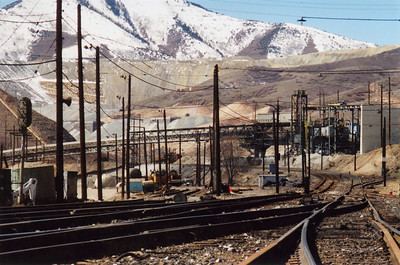 A view of the Dry Fork reload site (just above the bridge structure for the conveyor belt), as seen from Copperton Yard. The reload was about one mile up-canyon from Copperton. May 30, 2001.