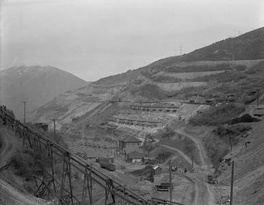 "With Copperfield in the foreground, looking at what has been called ""East Mountain,"" east of the Utah Copper open pit mine. By the late 1920s, almost all of the mountain and the ore veins under it were controlled by Montana-Bingham, and later by USSR&M. (USHS-39222002153463)"