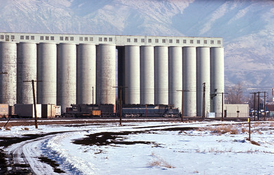 SP passing Sperry mill. Ogden. January 8, 1972.
