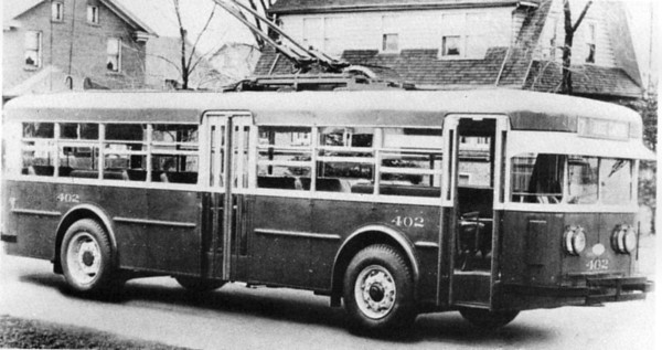 Utah Light & Traction liked the ride provided by the large tires and long springs on the Twin Coach Model 40TT. Note unusual (for Twin Coach) exit at middle instead of behind rear wheels. (Motor Bus Society; bw_5-5-20)