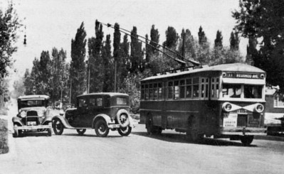 In possible another show of the trolley coaches' ability to swing wide around obstacles in their path, number 307 swings around a simulated automobile accident. (uebr_37-9_2a)