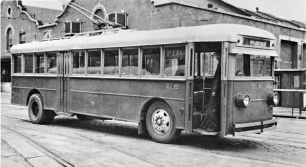 Salt Lake City Lines repainted its electric coaches into Pacific City Lines/National City Lines orange and cream divided by a thin black stripe. The colors were the same as the buses, but the design was much less intricate. Cincinnati 315 waits to go into service on the 7 line in 1944. Faintly visible is the SLCL logo midway along the lower panel. (Railway Negative Exchange; mca_39-3_3b)