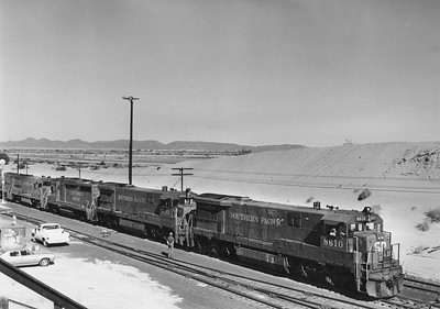 SPU33C_8610-with-train_Yuma-Ariz_Dec-1976_Emil-Albrecht-photo-11x14