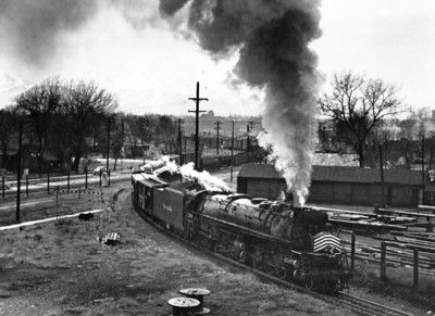 D&RGW 3708 passes through Grant Tower in April 1952. The train is bound for Ogden, and the photo was taken from the old North Temple Street viaduct. (Kindig Photo)