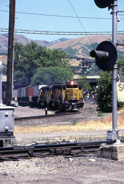 UP SD40-2 no. 3767 with westbound train, passing through Grant Tower trackage. July 1983. (Don Strack photo)