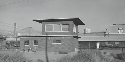 The Grant Tower building. \r\n\r\nGeographically, it''s an ideal spot for an interlocking plant. Trains run uphill in all three directions approaching the tower. Note the heavy exhaust from Rio Grande SW1200''s stacks. Soon the 132 and train will arrive at UP''s North Yard. (James Belmont Photo)October 1974. (Norm Metcalf Photo)