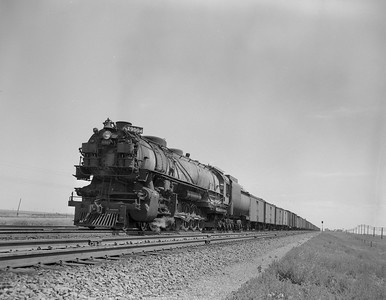 UP_4-12-2_9004-with-train_Archer-Wyo_July-1950_Jim-Ady-photo