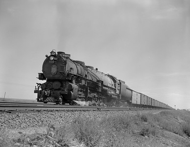 UP_4-12-2_9006-with-train_Archer-Wyo_July-1950_Jim-Ady-photo