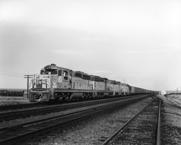 up-404_SD24_with-train_bosler-wyoming_aug-1959_jim-shaw-photo