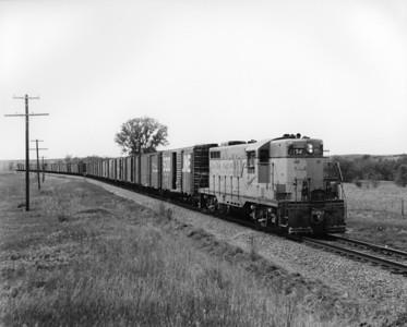 up-154_GP9_with-train_hays-kansas_aug-1957_jim-shaw-photo