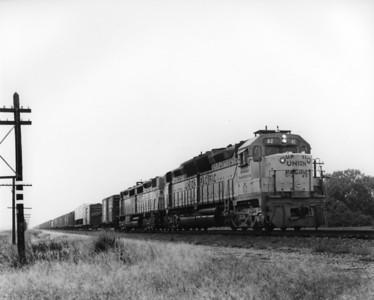 up-82_DDA35_with-train_ames-nebraska_sep-1970_jim-shaw-photo