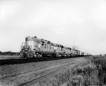 up-301_GP9_with-train_gothenburg-nebraska_aug-1956_jim-shaw-photo