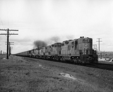 up-304_GP9_with-train_bosler-wyoming_aug-1957_jim-shaw-photo