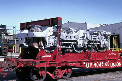 EMD HT-C truck awaiting installation at UP's Salt Lake City diesel shop. The red flatcars were assigned to this special service, between UP's Omaha shop, where the trucks were remanufactured, and various other shop locations on UP. July 1983. (Don Strack Photo)
