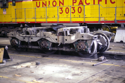 EMD Flexicoil C truck, as used on UP SD40 3030. Note that the unit in the background is sitting on a pedestal stand while its truck in the foreground is being worked on. Salt Lake City, June 1985. (Don Strack Photo)