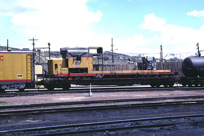 UP GP30 865. Wrecked in September 1983 and shown here in May 1984 in Salt Lake City on a flat car awaiting sale for scrap. Sold in November 1984 to Durbano Metals in Ogden. (Don Strack Photo)