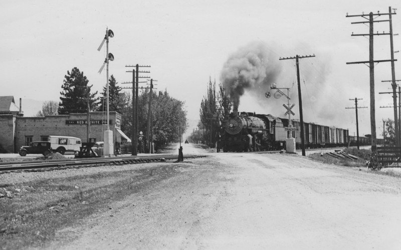 Woods Cross, looking south along 8th West from 5th South, showing railroad crossing. June 1939.