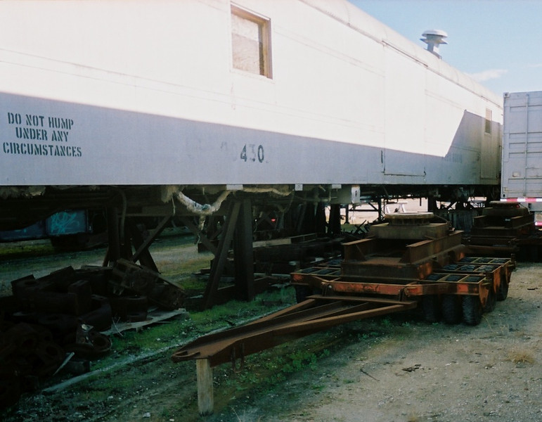 Dolly used to move rail cars around the Palmetto shop; shows ex-UP 90430x car in background, with illegible RBBX number. Rhett Coates Photo.