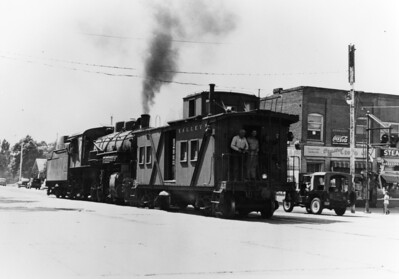 Tooele Valley Railway, eastbound on Vine Street, crossing Main Street.