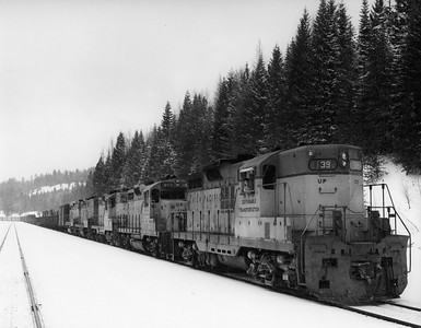 up-139_GP9_with-train-in-snow_uprr-photo