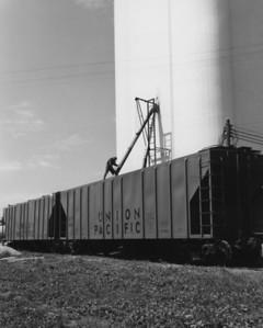 Loading CH-90-8 covered hoppers at Polk, Nebraska.