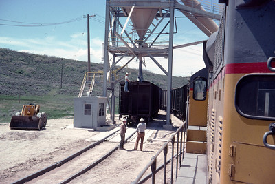 GP9s on the Park City Local, at the end of the line at Phoston, Utah, showing the loader that loaded phosphate rock into the hopper cars. June 1976. (Ralph Gochnour Photo)