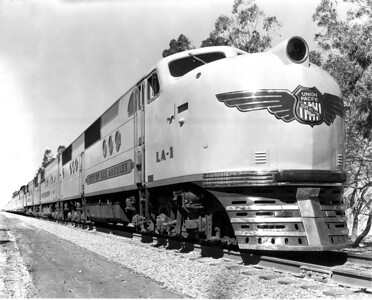 This publicity photo of LA-1 eastbound at Mira Loma shows one of the few examples of an altered photo in UP's historical archives. The jointly-owned LA-1 was delivered with the 'T' nose medallion, which contained the logos of both UP and C&NW. This photo was altered for wartime advertising to use the nose medallion as was used only on UP-owned locomotives. Compare this photo with the other photo at Mira Loma, also of LA-1, but on an westbound train, without the Overland Route bar across the UP shield. (Jeff Asay Collection)