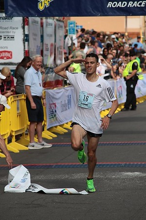 Mohamed Reda El Aaraby crosses the 2019 Boilermaker finish line in 2nd place