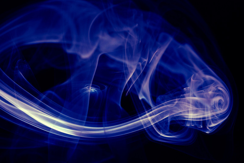 4/22/08<br /> Smoke from a candle I just blew out. Smoke is awesome looking, but unpredictable, so I had to take a lot of shots to have any good ones to choose from. I did extensive tweaking with the color balance tool to get the final image.