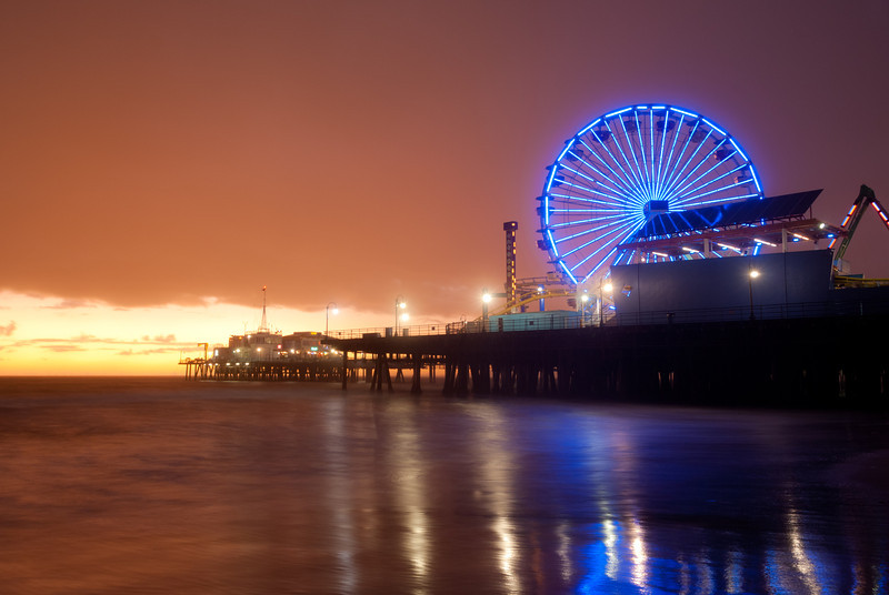 "<span id=""date"">_11/04/11_</span> <span id=""title"">Pleasure Pier</span> This is the Santa Monica Pier, which I've photographed many a time before. I felt like going down to the ocean to get a shot after it rained. Little did I know it would still be raining... You can't tell in this 9 second exposure, but believe me, I was getting wet. I kept the camera reasonably dry with a combination of a bandana, a tissue and hovering over the lens. Even so, most of my shots had drops in them, but this one came out almost totally clean. I also really like how the colors turned out. Read more about the shot, including what it looked like SOOC - <a href=""http://blog.jawsnap.net/2011/11/photo-setup-11411-pleasure-pier/"">Photo Setup Blog Post</a> Have a great weekend!  <a href=""http://www.jawsnap.net/Daily/year3/11272102_ACXDJ#1078271216_KQ7Kg"">[last year]</a> <em>culinary experiment...</em>"