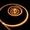 "<span id=""date"">_10/12/10_</span> <span id=""title"">Fiery Path</span> This photo is simply a lit candle on top of a running Roomba vacuum. I did a slight crop, otherwise it's straight from the camera. See the <a href=""http://www.jawsnap.net/Utility/Setups/8246339_SpVpq#1045861658_uxBXq"">setup photo</a> for more details...  <a href=""http://www.jawsnap.net/Daily/year2/7157835_BfJPF#679125803_QEnTS"">[last year]</a>"