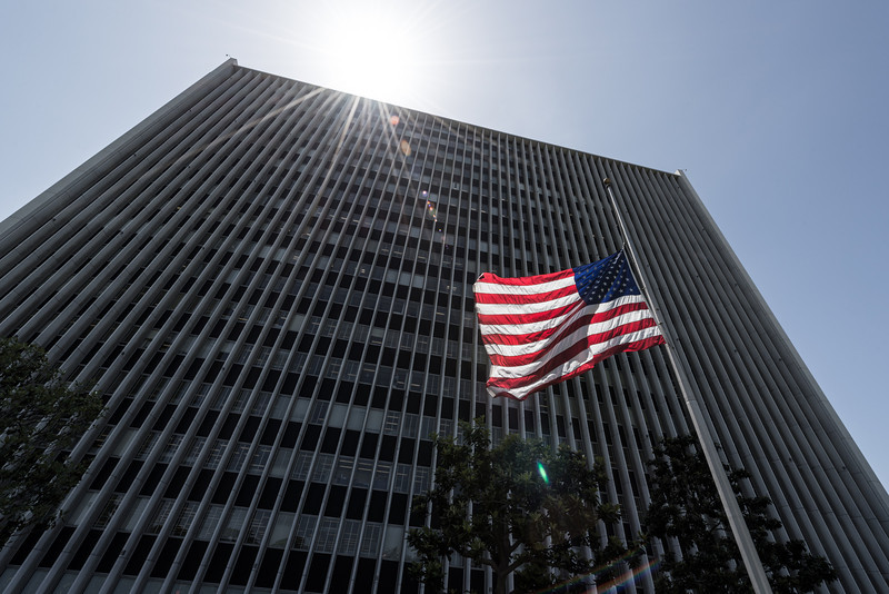 """<span id=""""date"""">2013-05-27</span> <span id=""""title"""">Memorial Day</span> The flag at half-staff in front of the massive Federal Building on Wilshire. Shortly after I had to return the rented 14-24mm lens - it's been fun.   <a href=""""http://www.jawsnap.net/Daily/year5/21694881_xSmBVj#!i=1871437148&k=7FQpR9k"""">[last year]</a>"""