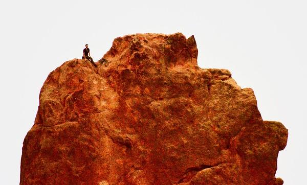 Abstract - A climber summits a blade at Garden of the Gods near Colorado Springs, Colorado