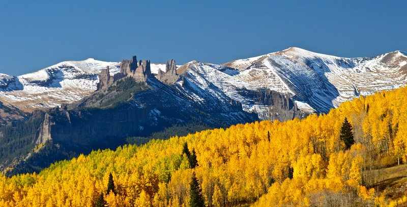 """The Castles' of the West Elk Range rise above the forest near Ohio Pass, Colorado"