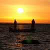 Fiskare i solnedgång